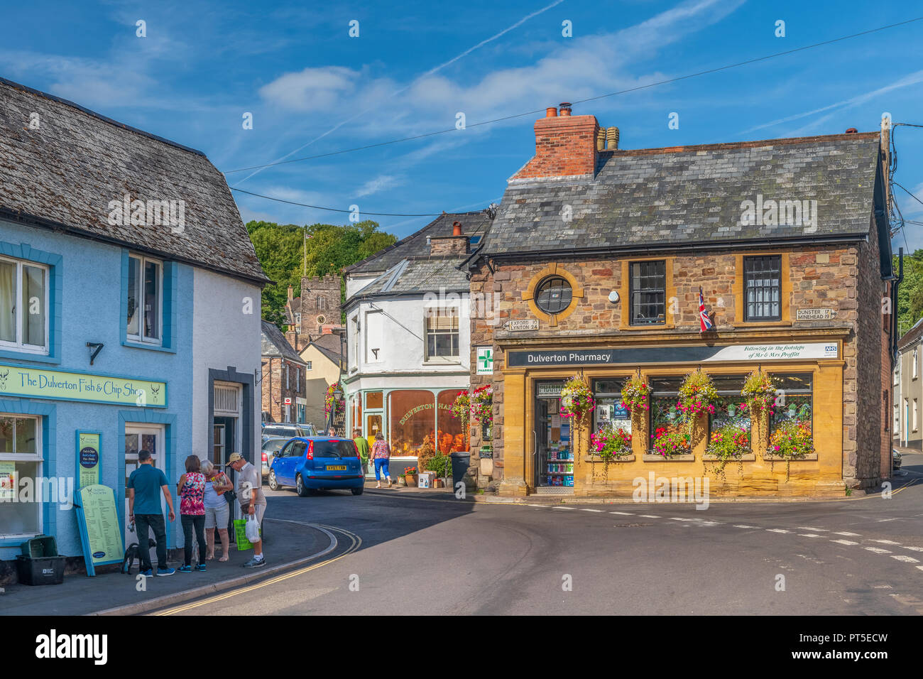 Visitors enjoy the summer sunshine in the small town of Dulverton in the heart of West Somerset. - Stock Image