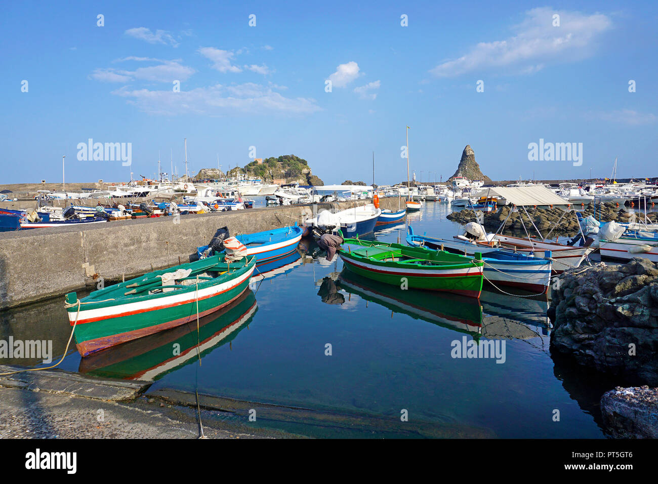 Harbour of fishing village Aci Trezza, behind the cyclops islands, comune of Aci Castello, Catania, Sicily, Italy Stock Photo