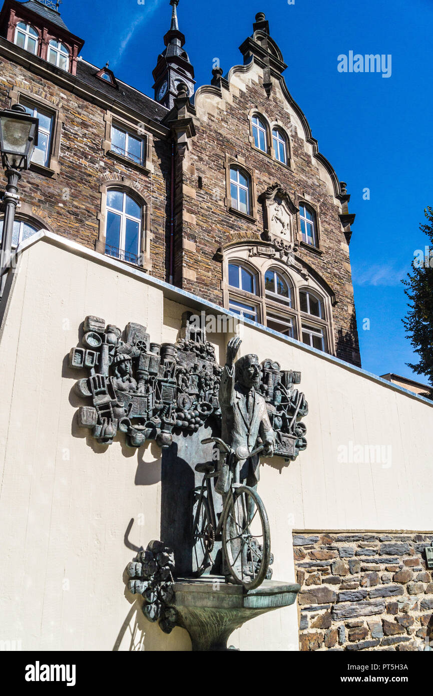 Fountain sculpture of Dr. Ernst Willen Spies, Middle Mosel museum founder, 1898-1975, with bicycle, Traben-Trarbach, Rheinland-Pfalz, Germany - Stock Image
