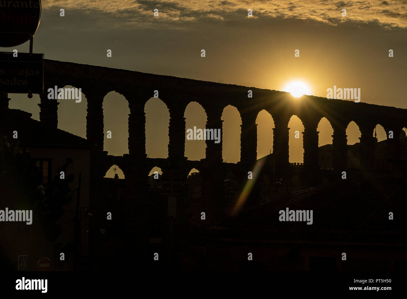 View of the famous Aqueduct of Segovia at Sunset. Roman construction of the 1st century. Travel concept. Spain, Castile and Leon, Segovia. - Stock Image