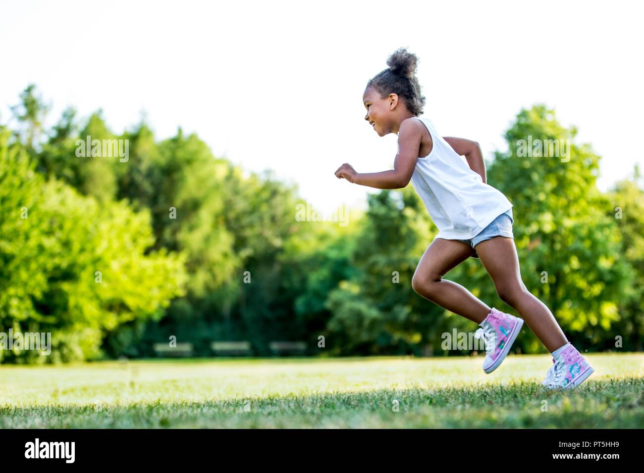 little girl running in park stock photos little girl running in