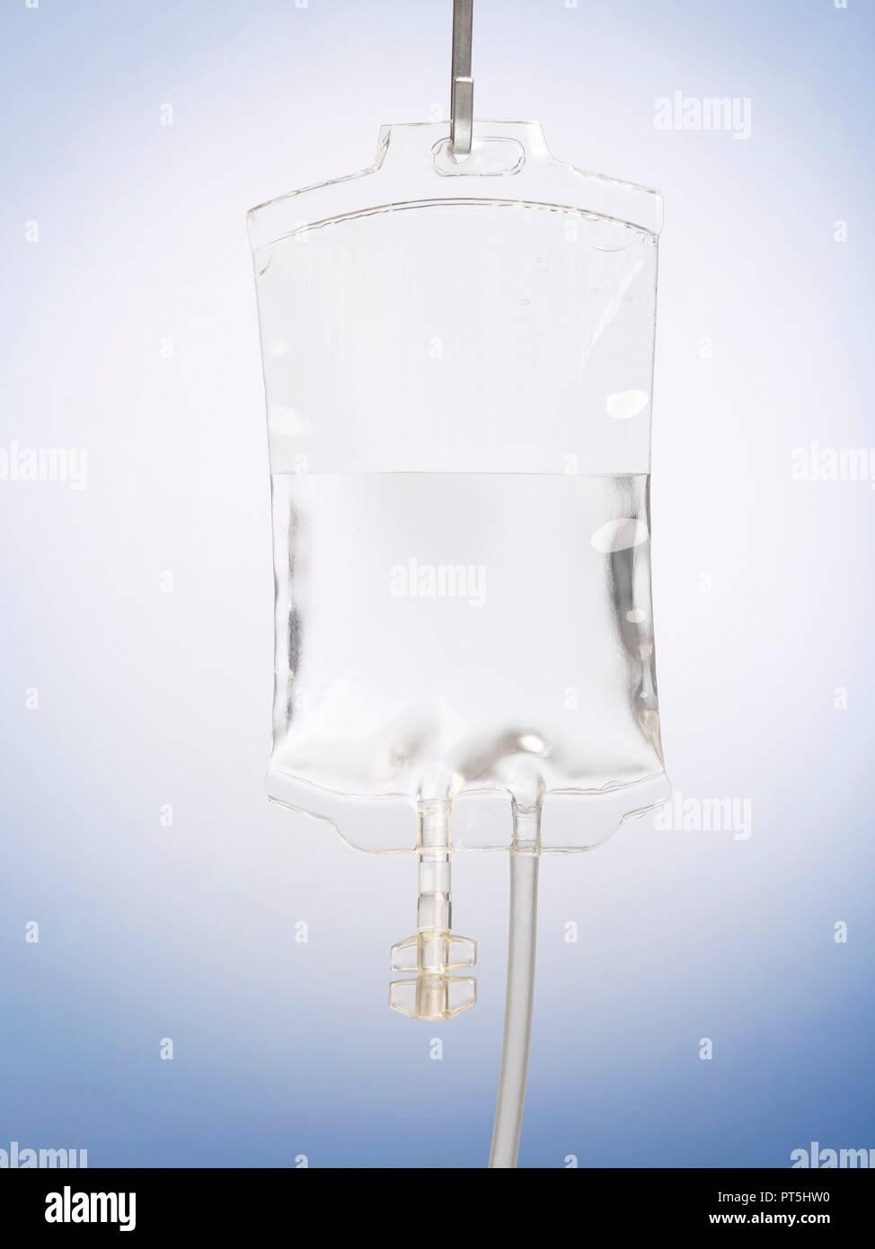 Intravenous drip against a plain background. - Stock Image