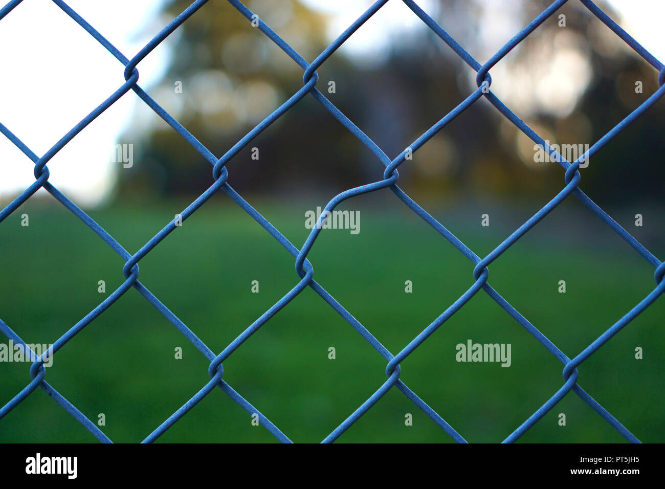Close up view of one irregular crooked line pattern of chain link fence Stock Photo