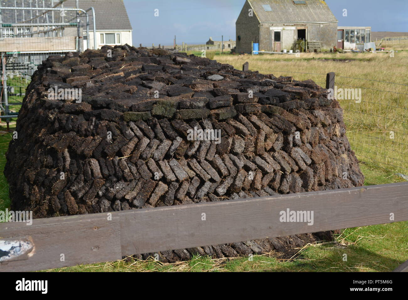 Peat slabs stacks drying in the open near Arnol Isle of Lewis Outer Hebrides Western Scotland UK United Kingdom re fuel source heating island life - Stock Image
