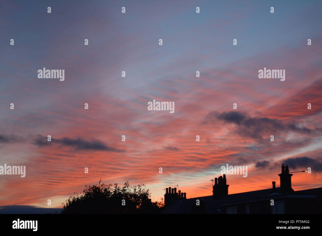 Red sky at night sunset in autumn over St Monans near Anstruther Fife Scotland UK United Kingdom Great Britain - Stock Image