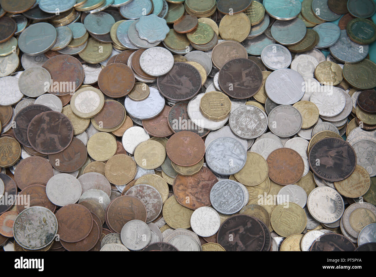 A collection of old world wide used coins. Stock Photo