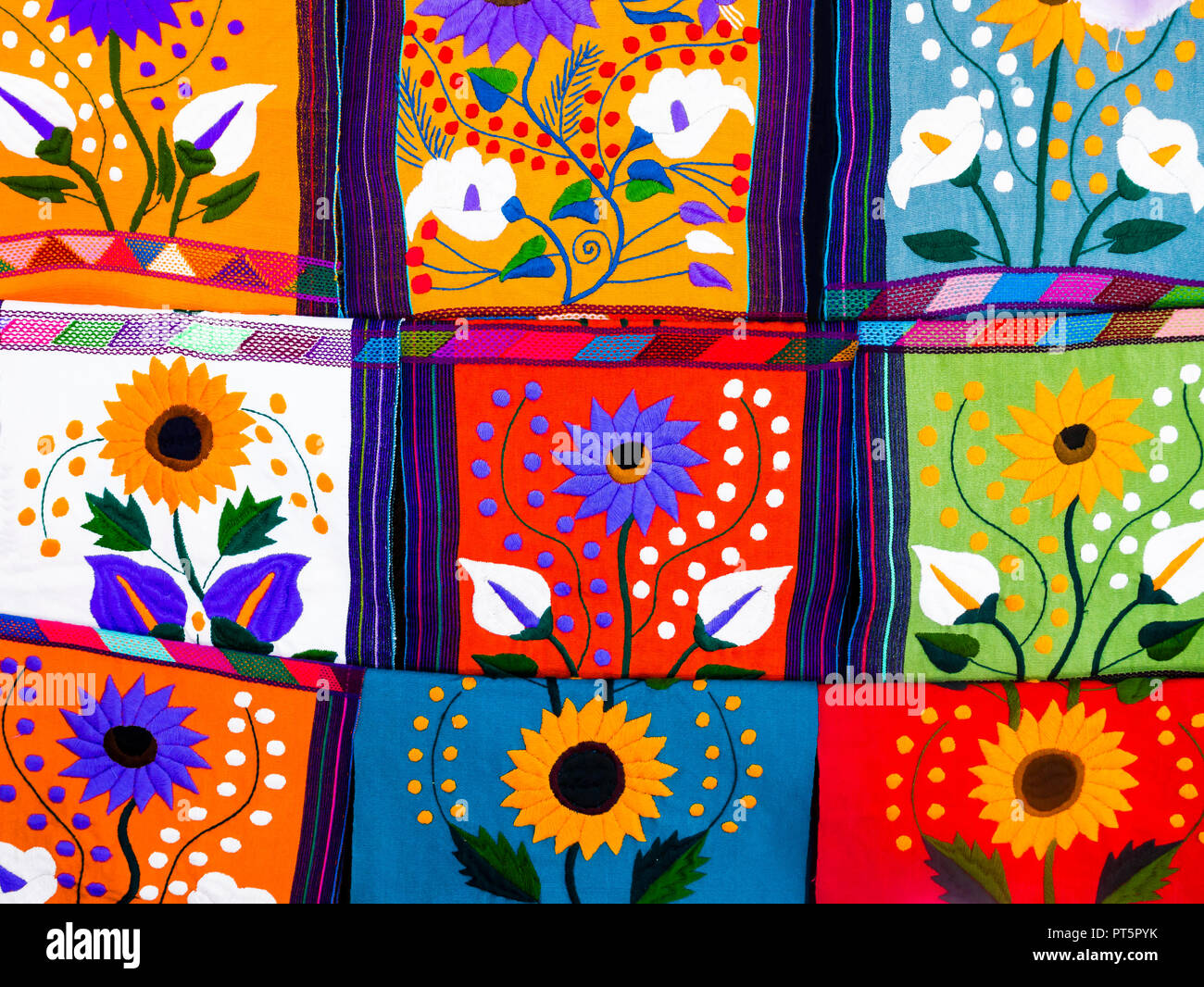 Multicolored ethnic placemats with floral patterns and geometric shapes Stock Photo