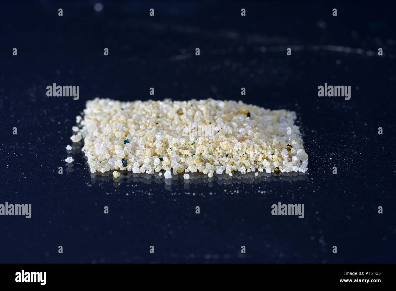Ammonium ferrous sulfate, is a salt consisting of iron, ammonium and sulfate ions - Stock Image