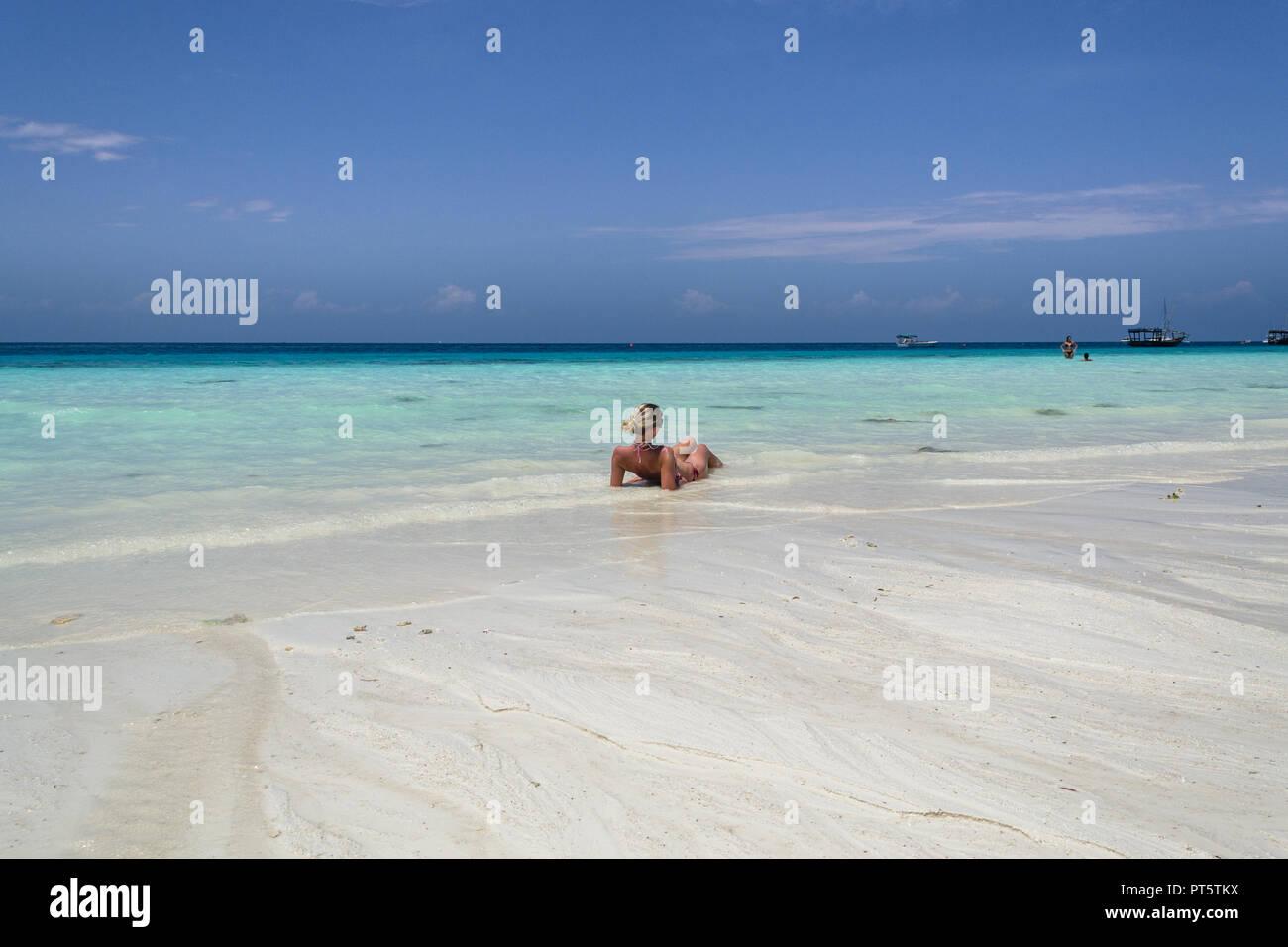 woman relax on the paradise beach, sanzibar nungwi, tanzania - Stock Image