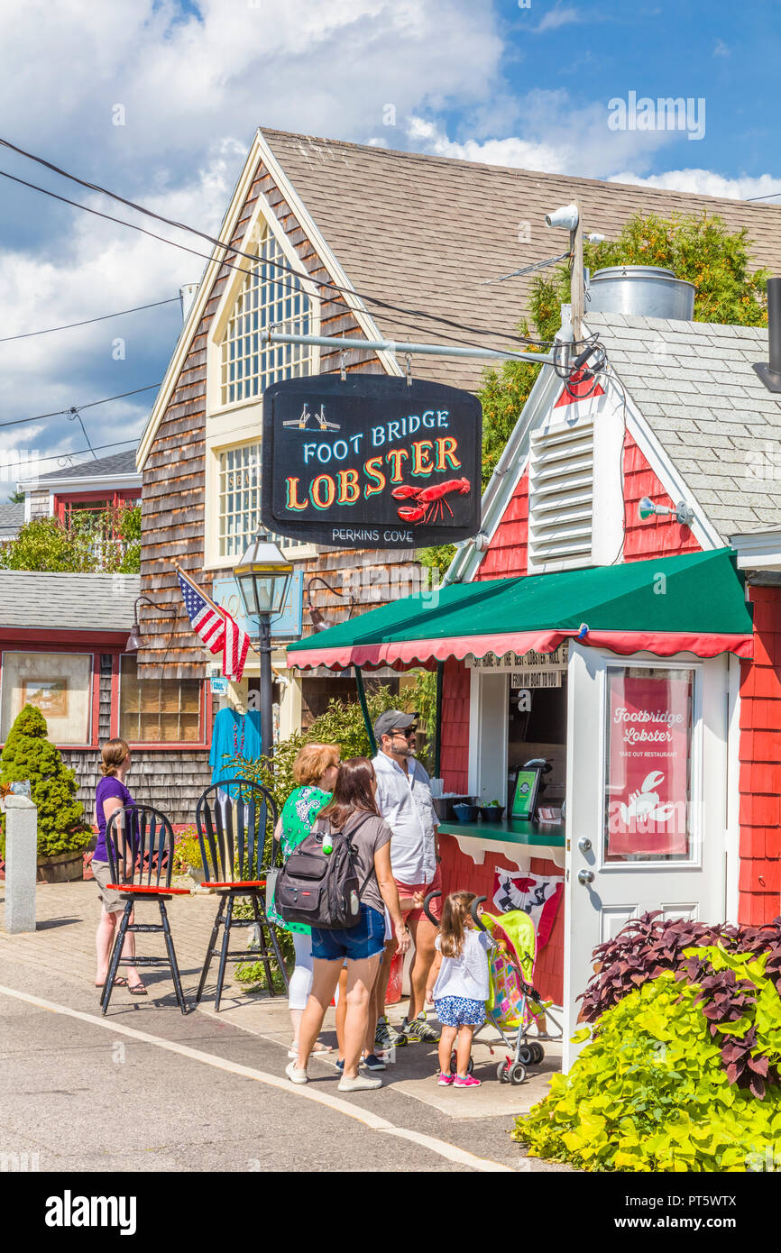 Family In Shops And Restaurant Area Of Perkins Cove In Ogunquit
