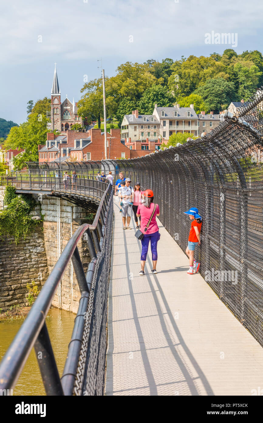 Appalachian Trail walkway on railroad bridge over Upper Potomac River in Harpers Ferry National Historical Park in West Virginia - Stock Image