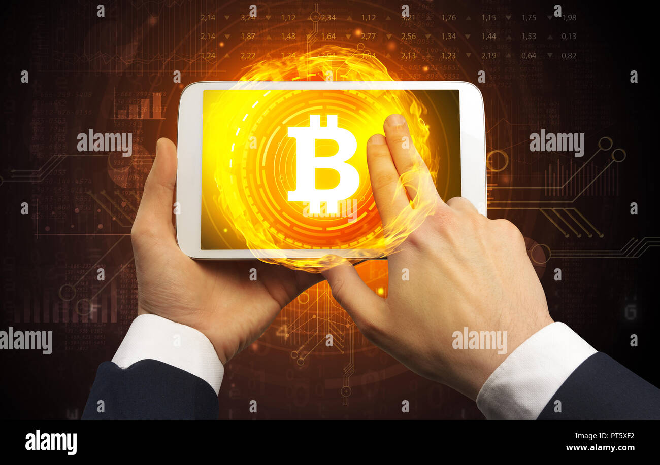 Elegant hand touching tablet with cryptocurrency concept  - Stock Image