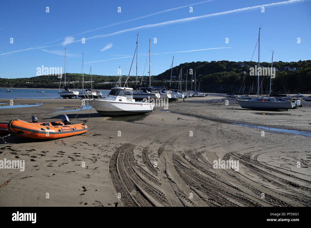 Boats and Yachts on the beach at New Quay, Ceredigion, Wales. Photograph taken 27th September 2018 - Stock Image