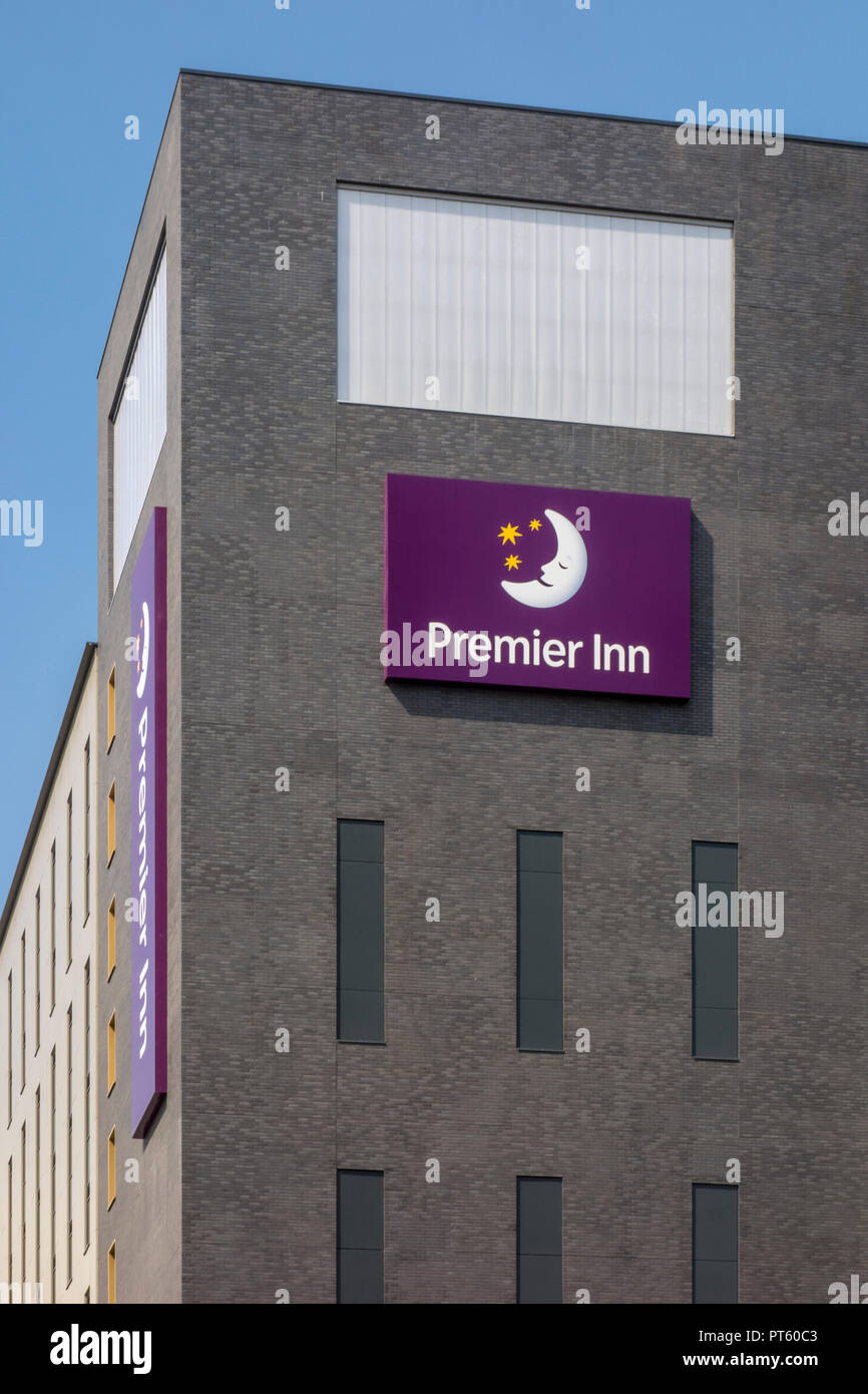 Sign and logo outside a Premier Inn hotel building owned by Whitbread in Wembley, London, UK - Stock Image