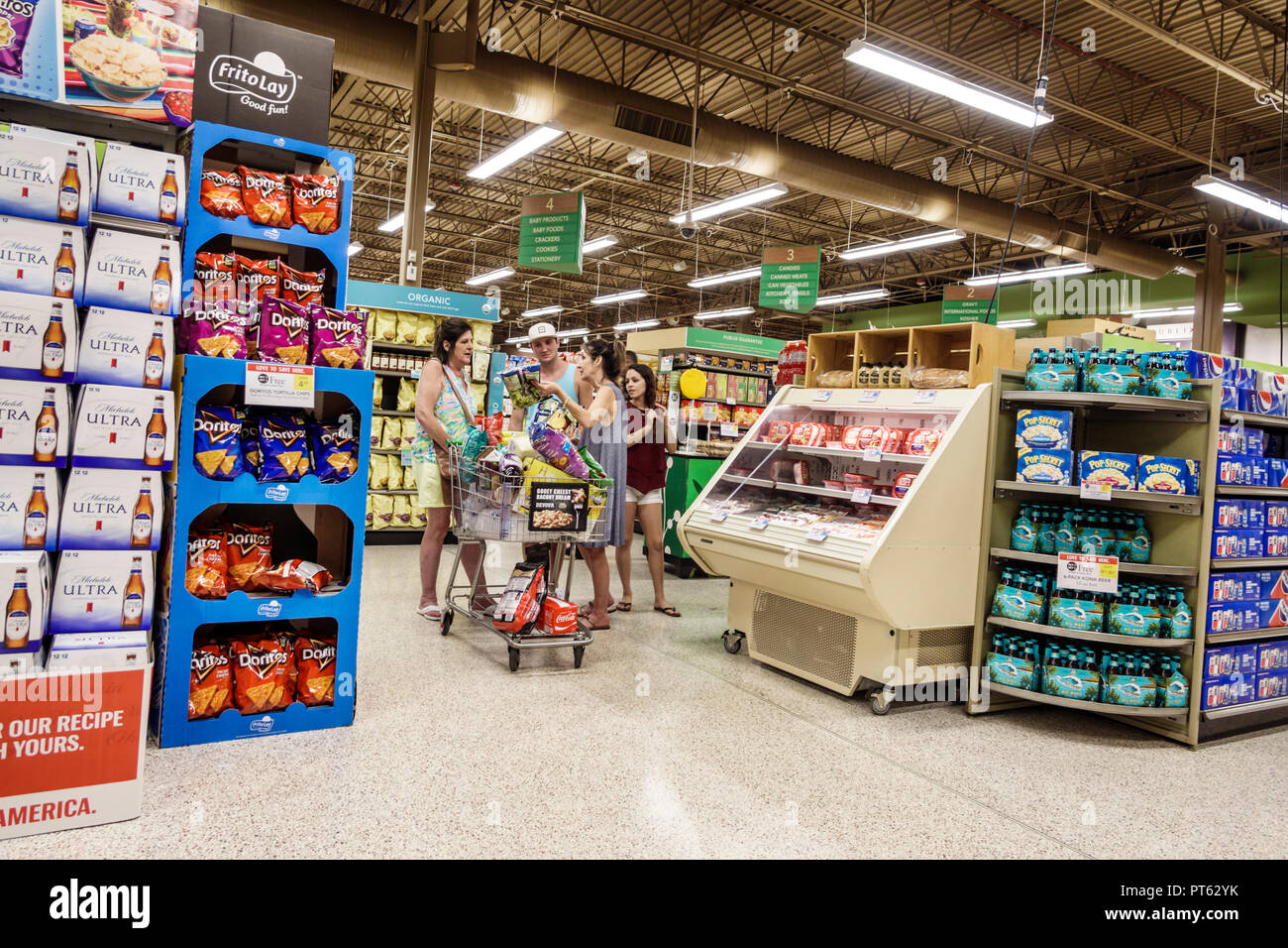 St. Saint Petersburg Florida Publix Grocery Store supermarket inside display sale family shopping cart trolley Frito Lay Doritos - Stock Image