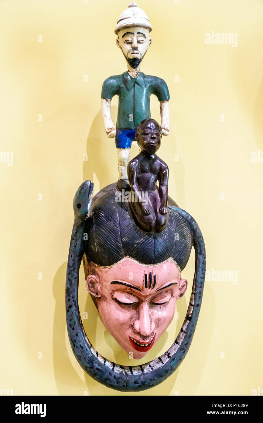 St. Saint Petersburg Florida Museum of Fine Arts interior mask Ivory Coast 1960 polychromed wood humor humour - Stock Image