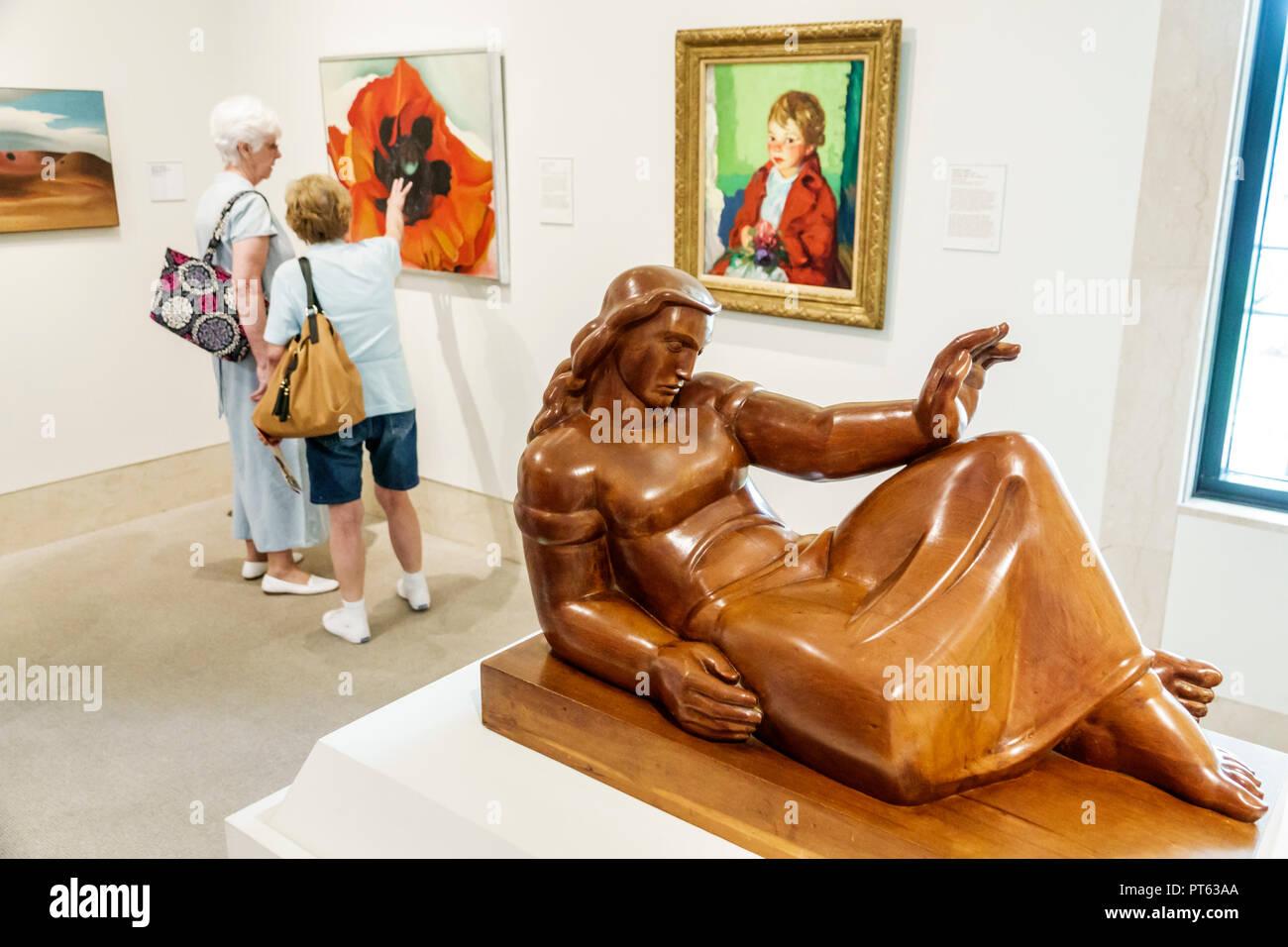 St. Saint Petersburg Florida Museum of Fine Arts interior Albert Wein artist New Horizons 1937 cherry wood senior woman friends - Stock Image