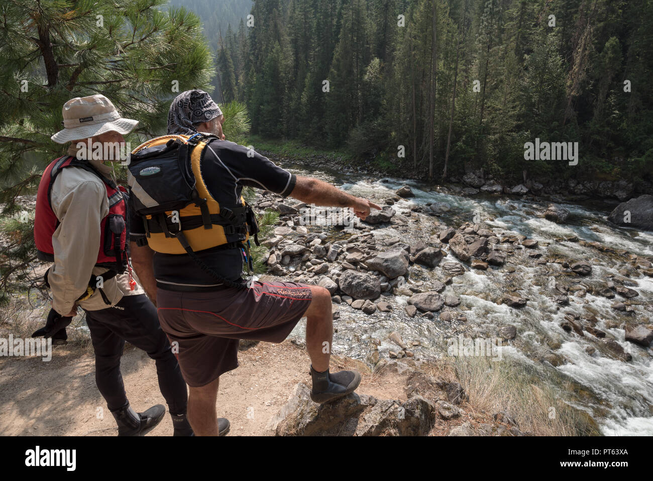 River runners scouting Wolf Creek Rapids on Idaho's Selway River. - Stock Image
