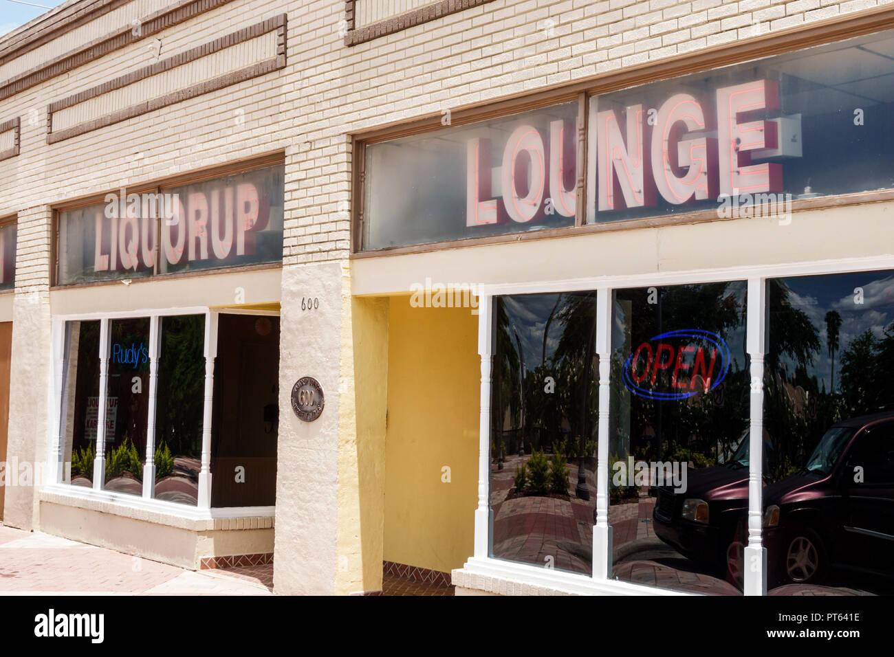 Florida Haines City Liquorup Lounge bar pub front entrance neon sign - Stock Image