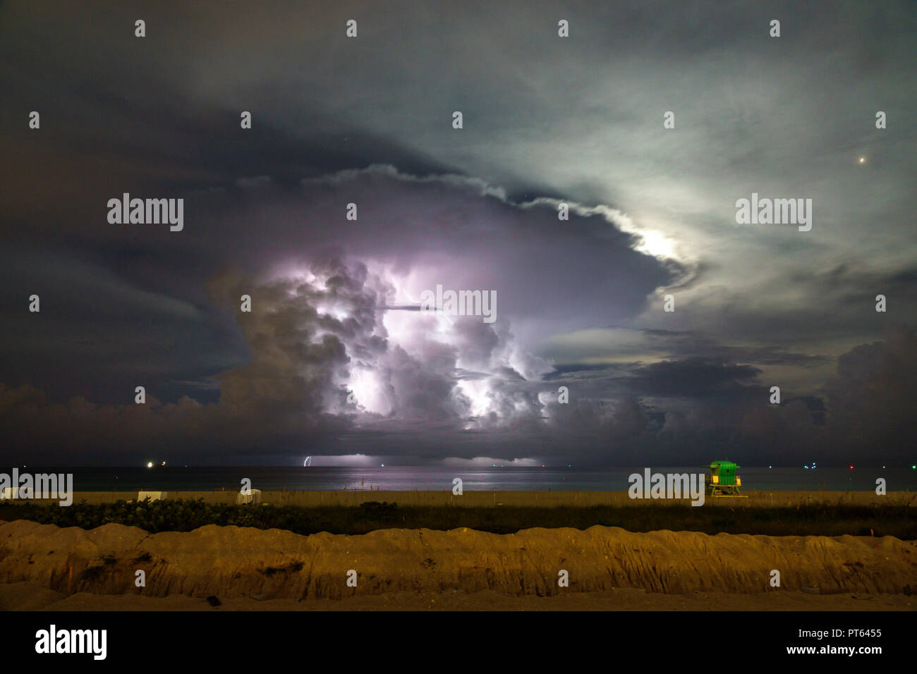 Miami Beach Florida Atlantic Ocean night weather thunderstorm storm lightning clouds - Stock Image