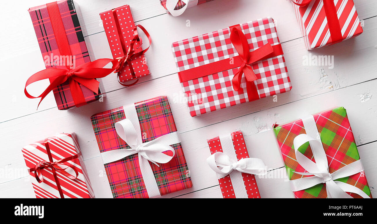 Top view of wrapped Christmas presents laid on the wooden table - Stock Image