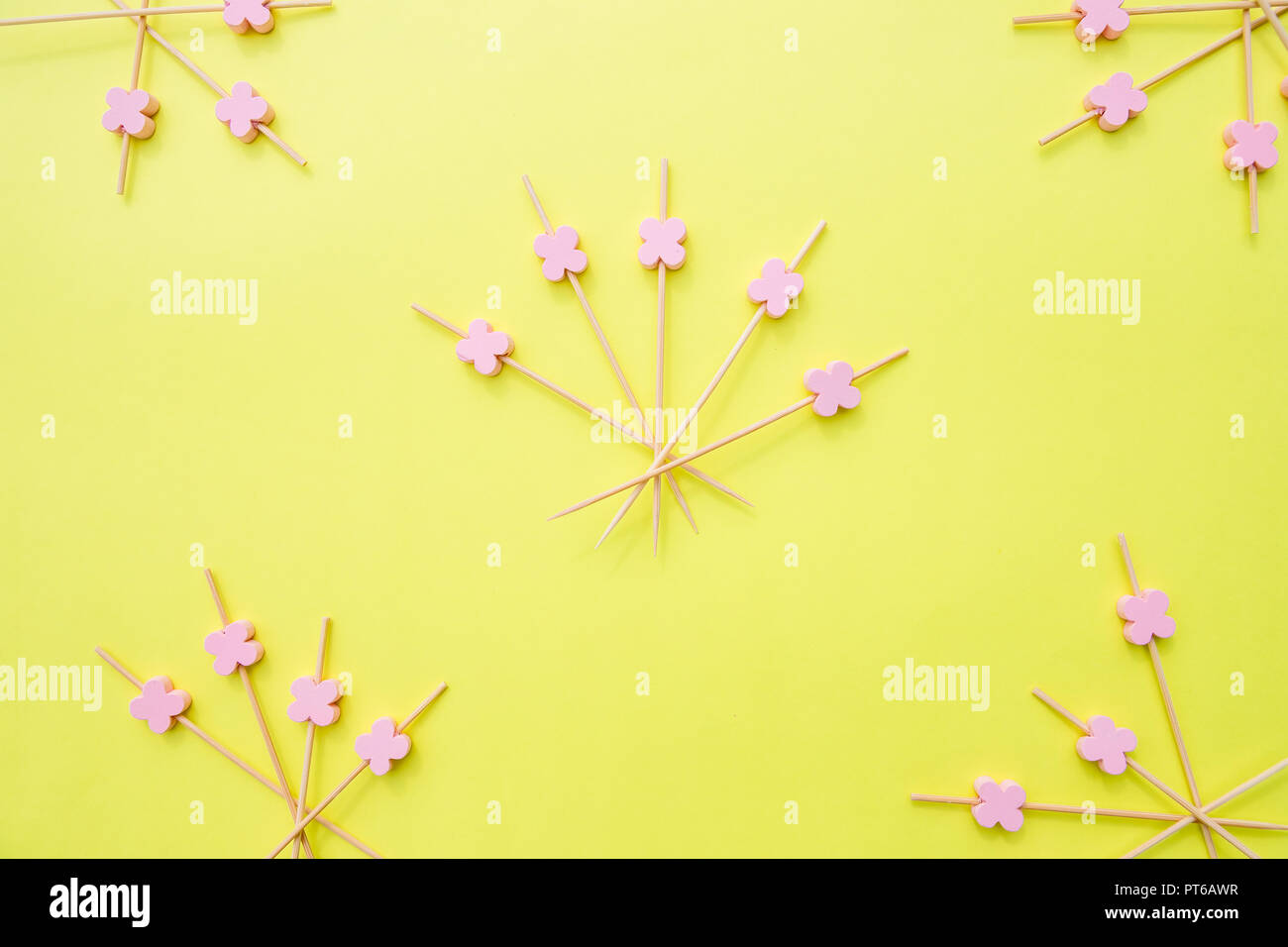 Catering concept. wooden bamboo sticks, Skewers for the preparation of canapes. Props for snack food. Wooden sticks in the form of a fan isolated on yellow background. - Stock Image