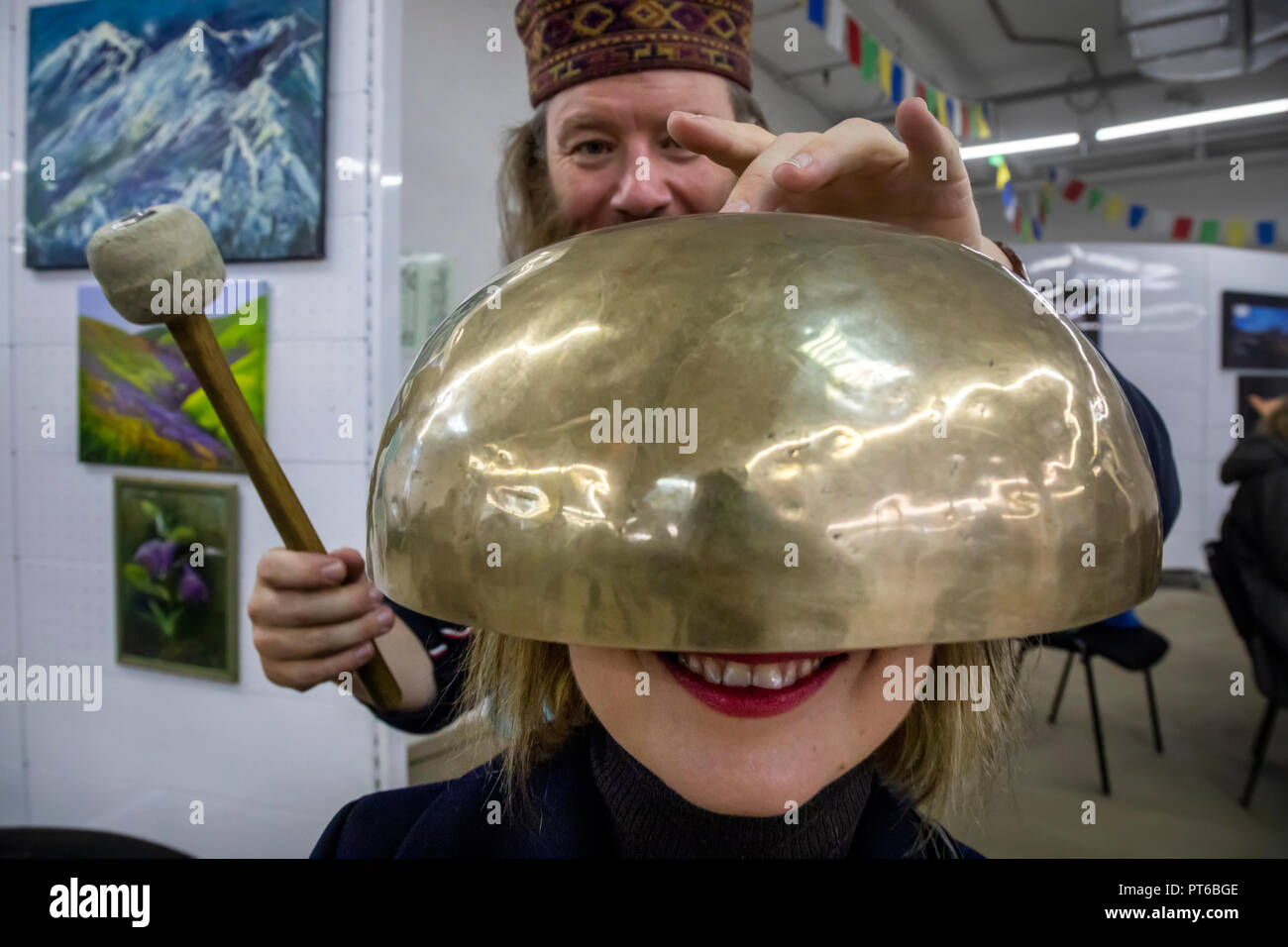 Using the Tibetan singing bowl during a sound therapy session at the Nepal Culture Festival in Moscow, Russia Stock Photo
