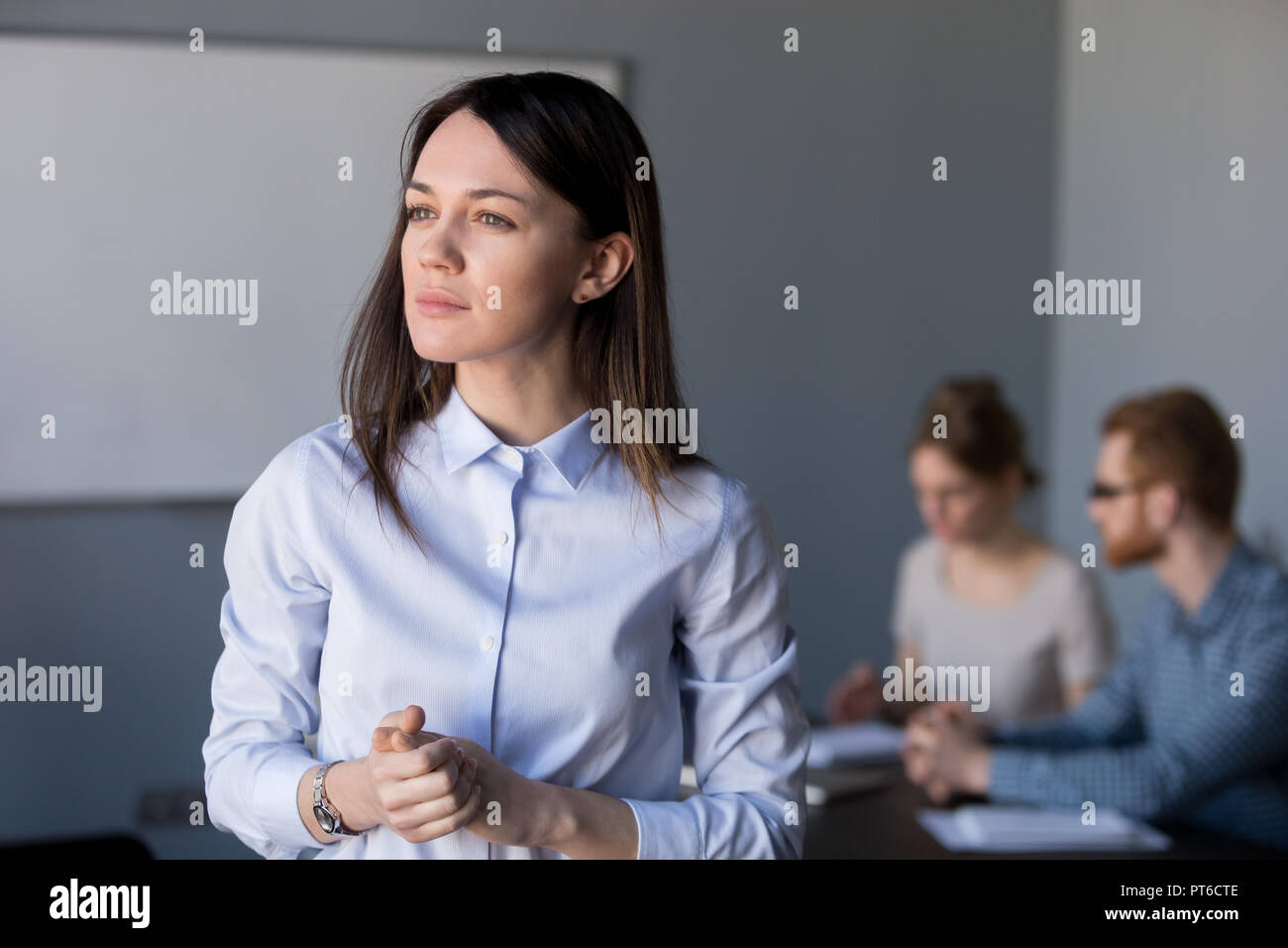 Thoughtful businesswoman looking away thinking of challenges, bu - Stock Image