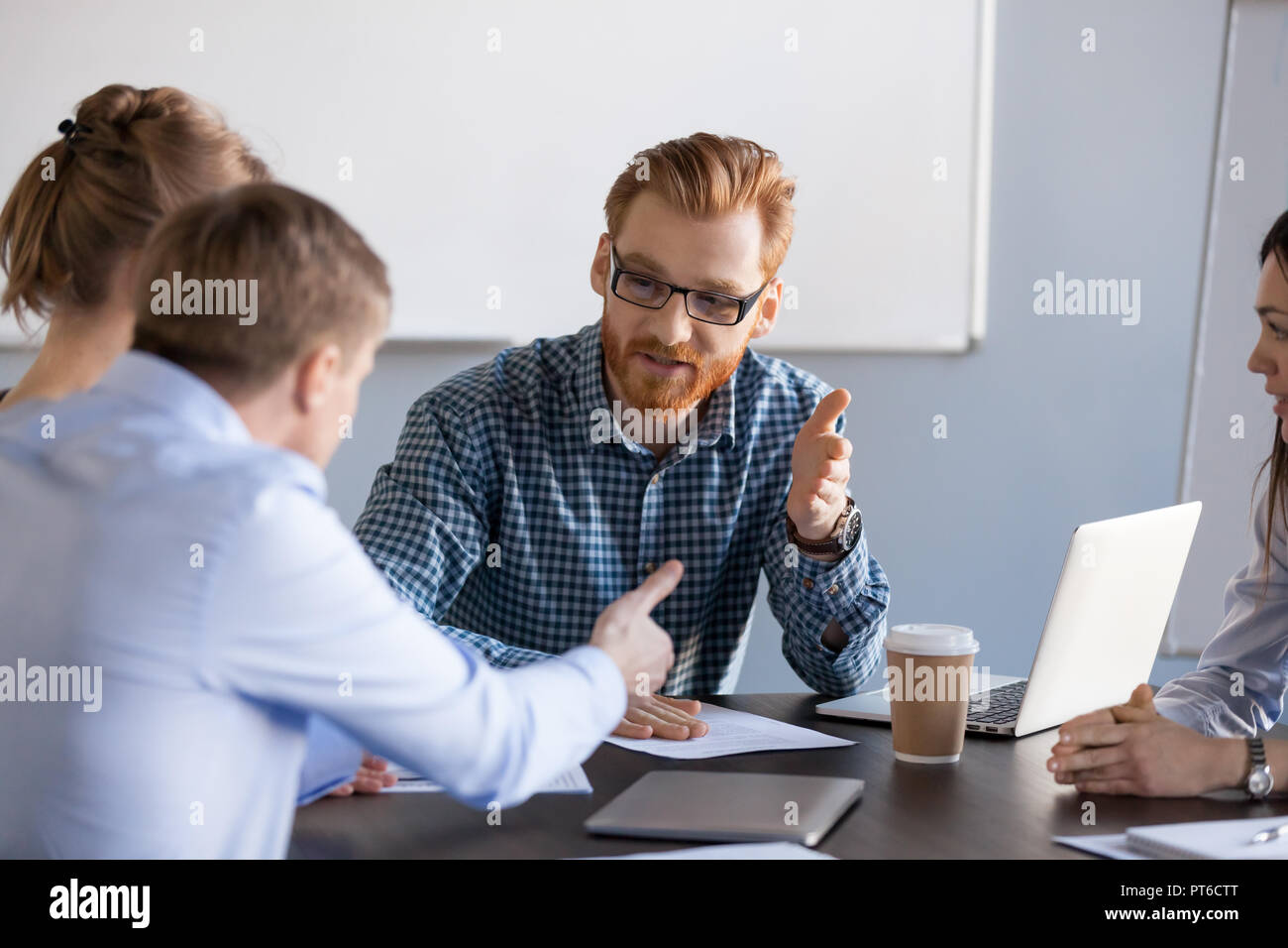 Serious business men having discussion, dispute or disagreement  - Stock Image