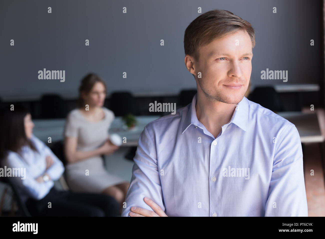 Confident thoughtful businessman team leader looking away dreami - Stock Image