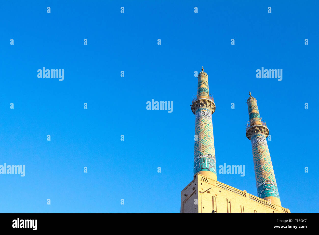 Jameh mosque, with its distinctive tiles minarets, seen in the afternoon. Jameh mosque is one of the symbols of the city of Yazd, in the middle of the Stock Photo