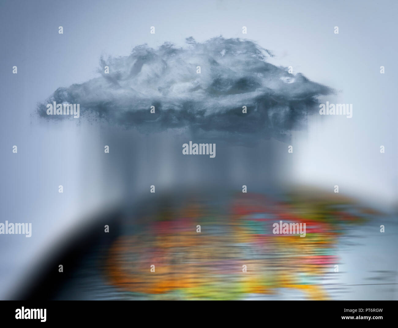 Concept A Rain Cloud Pouring on a Globe, World Weather - Stock Image