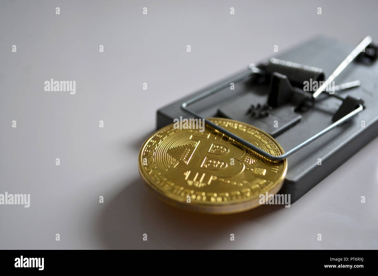 Bitcoin caught in a mouse trap - Stock Image