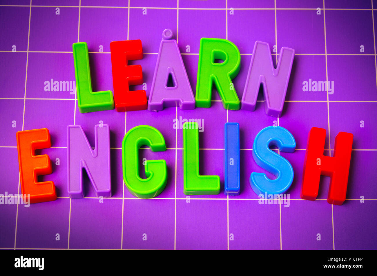learn english language alphabet on magnets letters - Stock Image