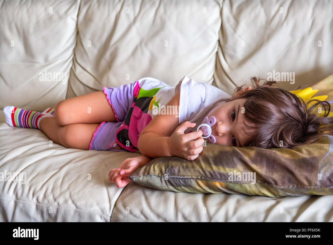 afternoon nap baby napping child couch bedtime sofa lullaby - Stock Image