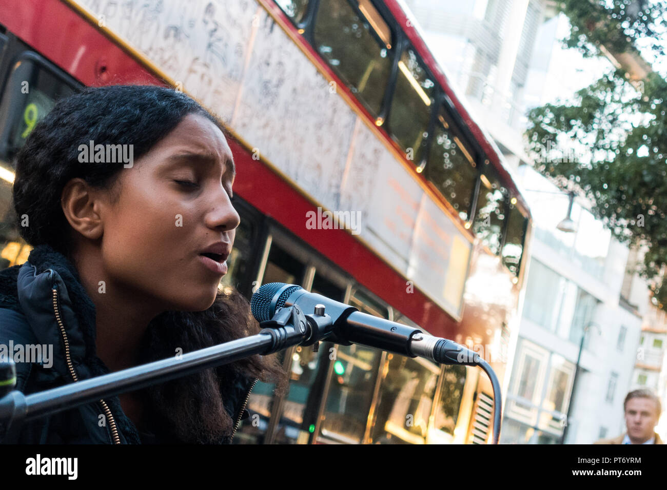 Harmonie London, street entertainer, on keyboards and vocals, Oxford Street, London, UK, Europe. - Stock Image