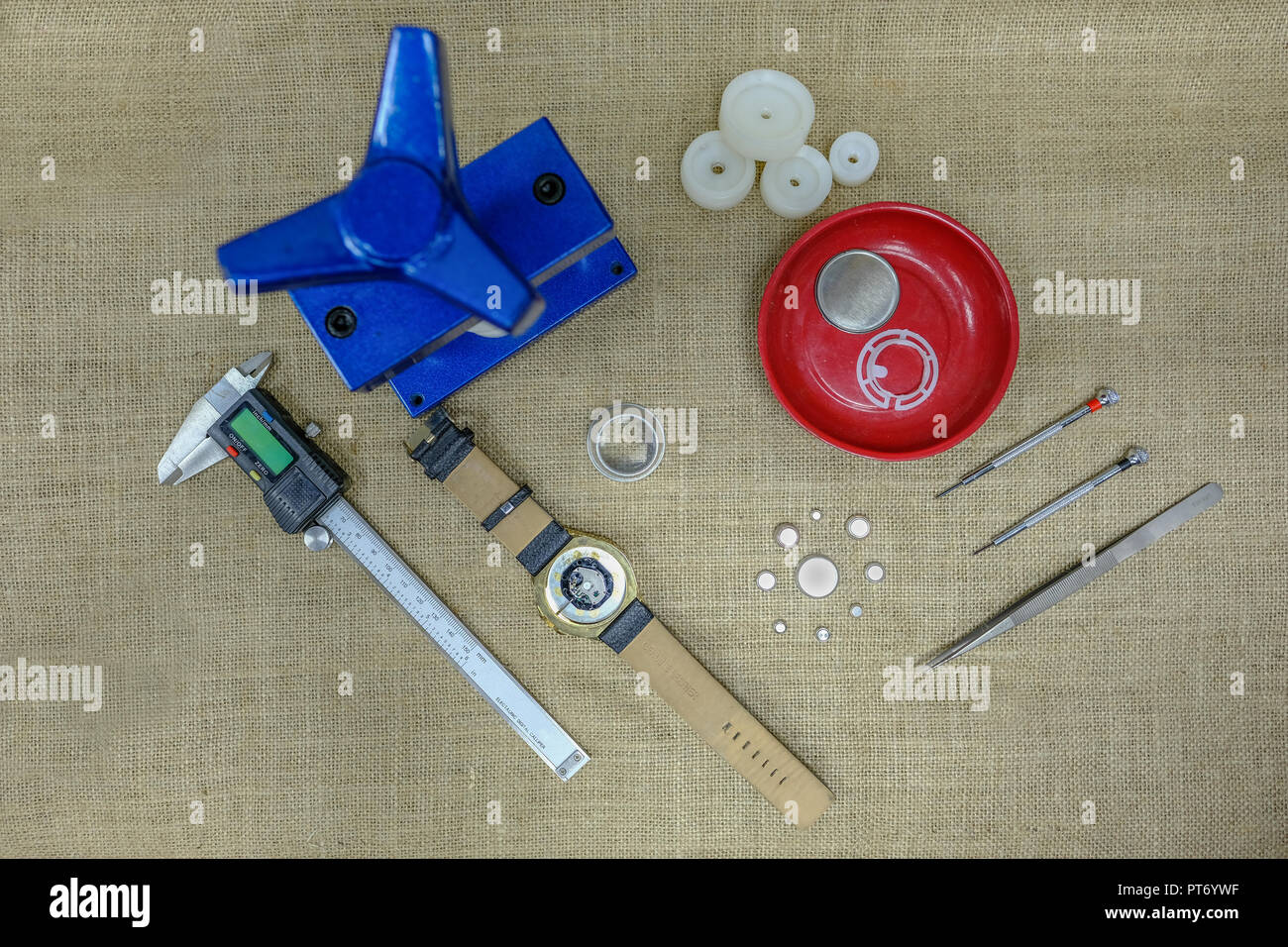 Top view of tools and equipment used to change a watch battery. - Stock Image