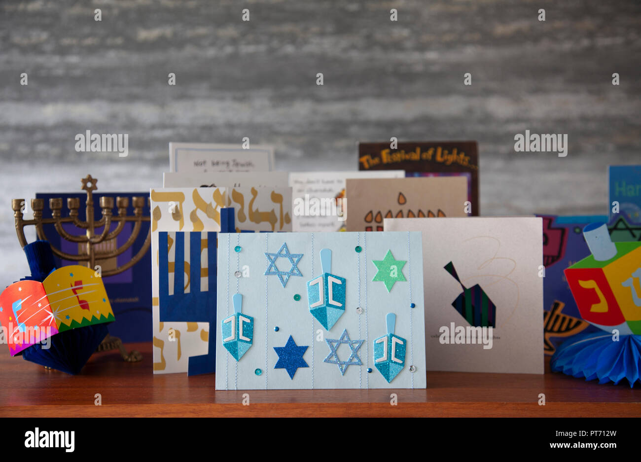 Selections of greetings cards, a chanukiah and decorative dreidls. Jewish festival of Hanukkah aka chanukkah, Chanukah, Hannuka, - Stock Image
