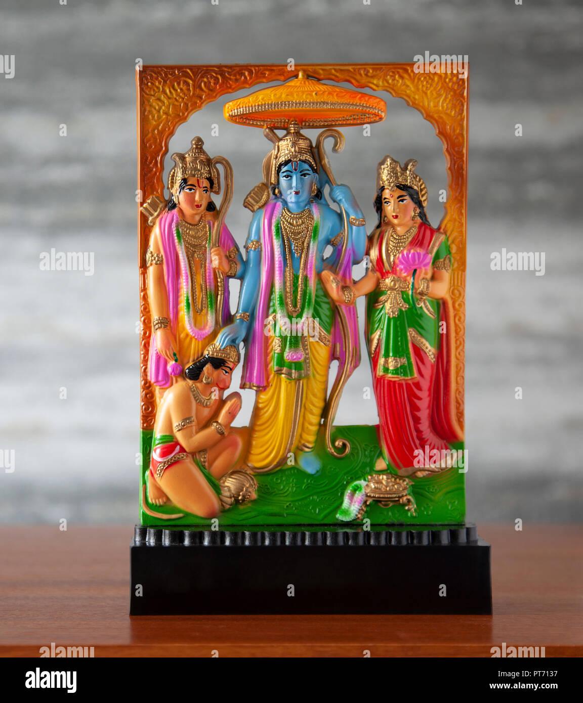 Small moulded plastic, standalone Ram Darbar sculpture, a Hindu religious artefact with Sri Ram, Sita, Lakshman and Hanuman the monkey god. Ramayana, - Stock Image