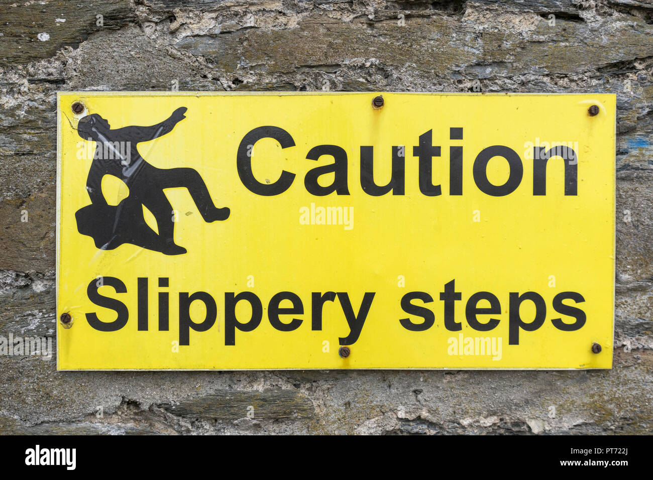 Slippery steps warning sign at Newquay harbour. - Stock Image