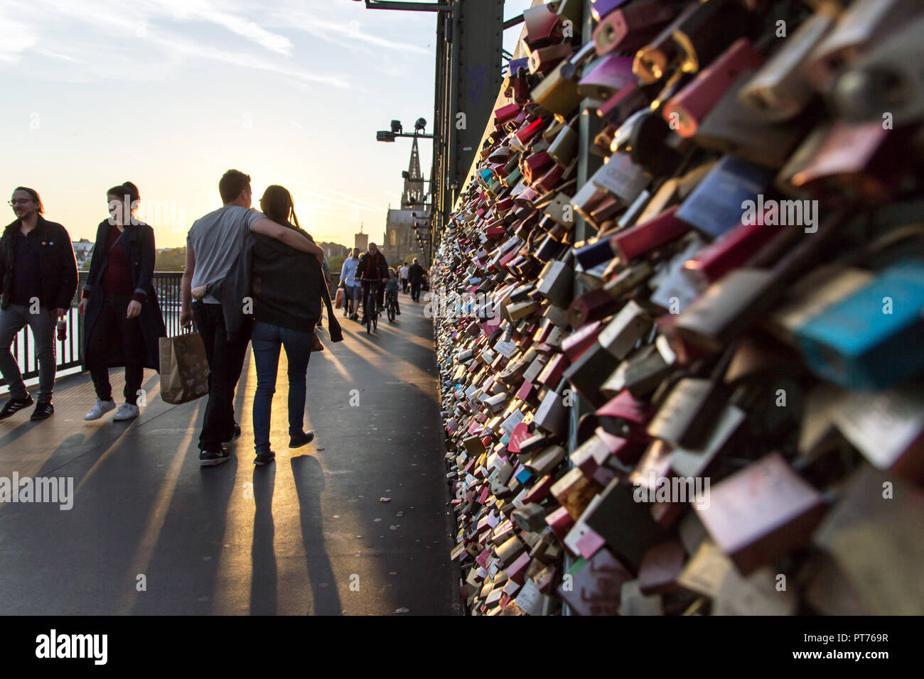 COLOGNE, GERMANY- OCTOBER 06, 2018: Tourists on the Hohenzollern Bridge. as a sign of strong love or strong friendship, loving couples or groups of co Stock Photo
