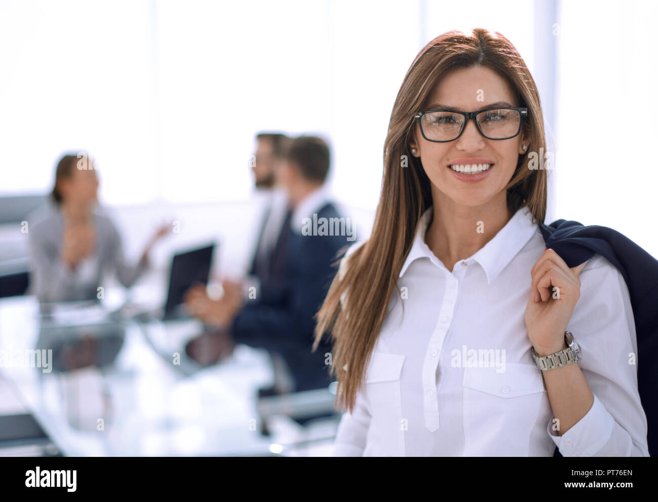 modern business woman on the background of the office - Stock Image