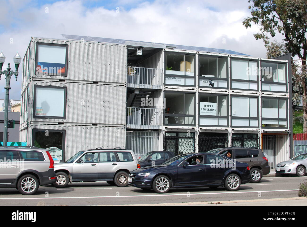 The MacArthur Annex, a mixed-use building made of shipping containers by Baran Studio Architecture that houses office and retail near MacArthur BART. - Stock Image