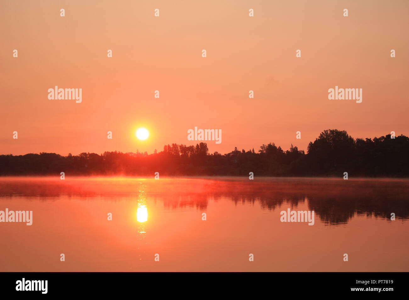 Colorful rising sun - Stock Image