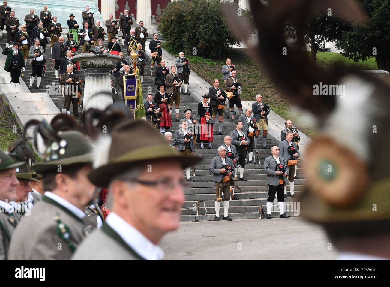 Munich, Bavaria. 07th Oct, 2018. The shooters take off their hats after the traditional saluting gun shooting on a staircase at the Theresienwiese on the last day of the October Festival 2018. Credit: Felix Hörhager/dpa/Alamy Live News - Stock Image