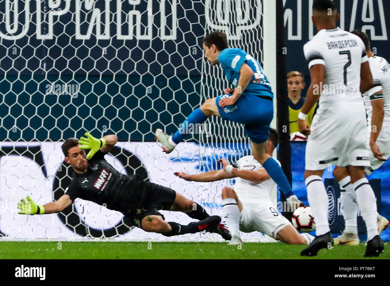 St Petersburg, Russia. 07th Oct, 2018. MOSCOW, RUSSIA - OCTOBER 7, 2018: FC Krasnodar goalkeeper Stanislav Kritsyuk (L) supported by Wanderson (R front), Sergei Petrov (R back) defends against Zenit St Petersburg's Daler Kuzyayev (C) in their 2018/19 Russian Premier League Round 10 football match at Saint Petersburg Stadium. Alexander Demianchuk/TASS Credit: ITAR-TASS News Agency/Alamy Live News - Stock Image