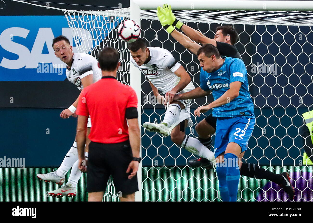 St Petersburg, Russia. 07th Oct, 2018. ST PETERSBURG, RUSSIA - OCTOBER 7, 2018: FC Krasnodar's Sergei Petrov Uros Spajic, goalkeeper Stanislav Kritsyuk (L-R back), and Zenit St Petersburg's Artyom Dzyuba (R front) in their 2018/19 Russian Premier League Round 10 football match at Saint Petersburg Stadium. Alexander Demianchuk/TASS Credit: ITAR-TASS News Agency/Alamy Live News - Stock Image