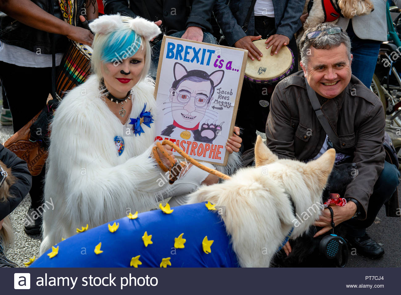 London, UK. 7th Oct 2018. Madeleina Kay (EU Supergirl). Dog owners gather for a massive 'walkies' to protest against Brexit.   This fun event organised by Wooferendum was entirely self funded. Supporters include Dominic Dyer, Stella Creasy MP, and Felicity Kendall.  London, Great Britain, 07 Oct 2018 Credit: David Nash/Alamy Live News - Stock Image