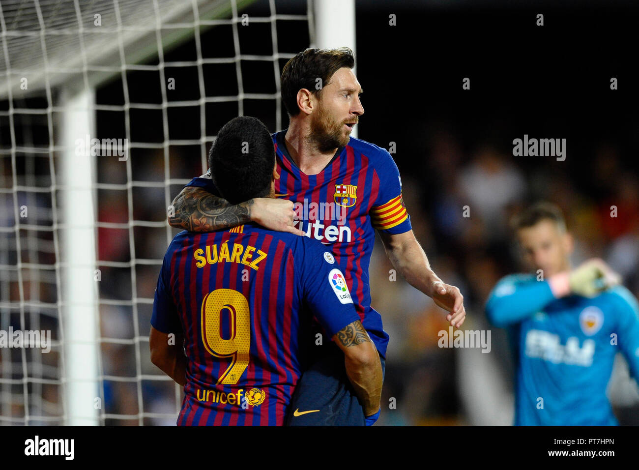 Leo Messi celebrates after scoring his sides first goal during the week 8  of La Liga match between Valencia CF and FC Barcelona at Mestalla Stadium  in ... 4fd3399104ee9