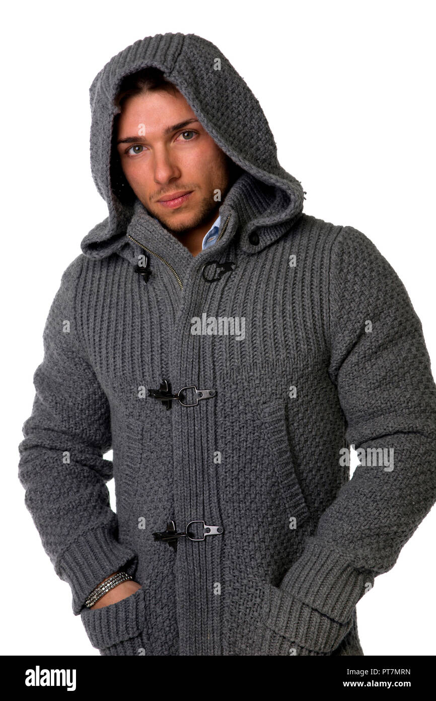 71b2940a Good looking young man wearing winter hoodie sweater Stock Photo ...